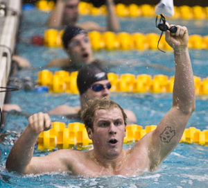 Tommy Wyher of the University of North Carolina celebrates a new ACC Conference 100 butterfly record in edging out Florida State's Jarryd Botha by 2/100 of a second in a winning time of 46.21.