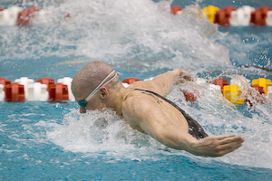 UVA's Pat Reams swims to victory in the 200 butterfly in 1:43.82