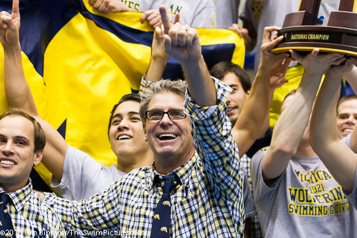 Coach Mike Bottom and the University of Michigan team celebrate their victory in the 2013 NCAA Division 1 Swimming and Diving Championships