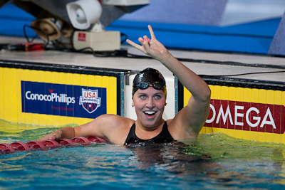 Kathleen Hersey flashes the University of Texas hookem horns after taking the 200 butterfly and a US Team World Championship spot at the 2009 ConocoPhillips USA National Swimming Championships and World Championship Trials