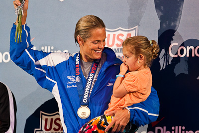 Dara Torres on the victory stand with her daughter following her win in the 50 free at the 2009 ConocoPhillips USA National Swimming Championships and World Championship Trials